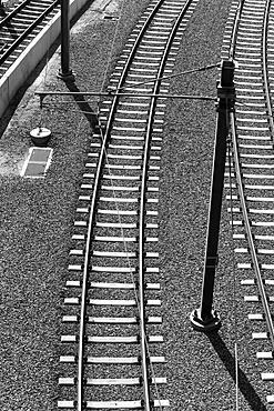 High angle view of empty parallel electric railroad tracks, California