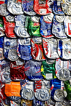Flattened soft drink cans.