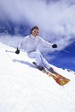 Woman spring skiing in Utah.