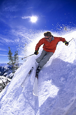 Man spring skiing on a sunny day in Utah.
