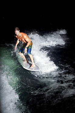 Male wakesurfing in Idaho.