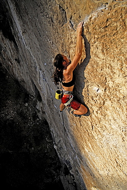 A rock climber ascends a steep rock face in Mexico.