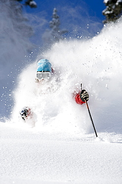 A man skiing some deep powder at Snowbird Utah.
