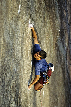 Yon Lambert bears down on tiny holds on Pawing The Void (5.12b/c) on the Southwest face of Cedar Rock near Brevard, NC