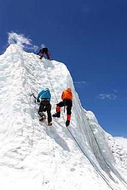 Mountaineers climbing up the Khumbu Icefall on the route up Everest, Everest Base Camp, Khumbu, Nepal
