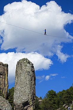 A man of France, walks on the slackline in Los Monjes valley near Creel, Chihuahua, Mexico
