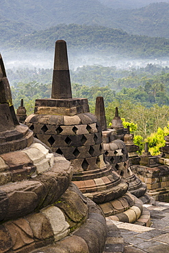 Sunrise at the Buddhist stupa and temple complex, Borobudur. Borobudur was completed in 825 AD and is currently a UNESCO World Heritage Site.