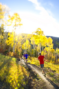 Group of people running on a trail in Park City, Utah