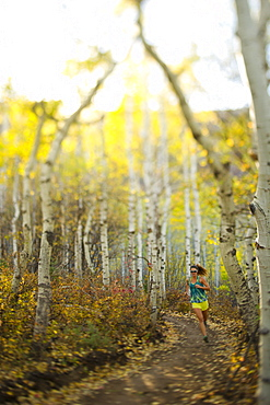 Woman running on a trail in Park City, Utah.