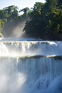 One kayaker dropping a 50 ft waterfall in Cascadas de Agua Azul, Chiapas, Mexico.