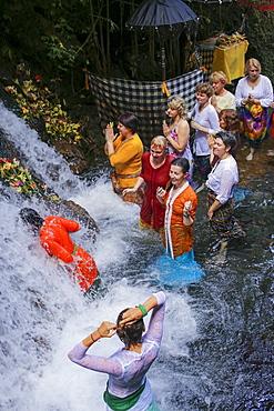 Balinese ceremony in waterfall,Bali,Indonesia.
