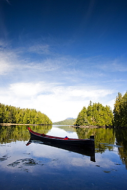 A canoe, carved with the traditions of the native peoples of Vancouver Island, in a small inlet near Tofino, Canada