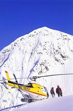 Ingrid Backstrom and Shane McConkey scoping a line in Haines, Alaska, United States of America