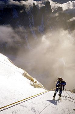 A mountaineer rappels down Cerro Torre's south east ridge in the early morning, after an ascent of the peak in Argentine Patagonia. Cerro Torre is one of the most difficult and iconic peaks in the Southern Andes, and is a highly sought after summit by the worlds top alpinists, Argentina