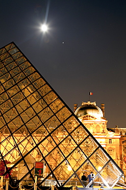 The Louvre Pyramid at night, Paris, France.
