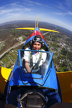 In flight view of a pilot in a Boeing PT-17 Stearman aircraft over Fayetteville, WV