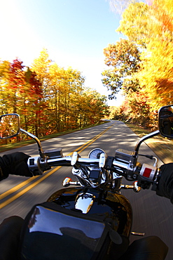 Motorcycle rider out for a cruise on a beautiful fall day on the Blue Ridge parkway south of Asheville, NC