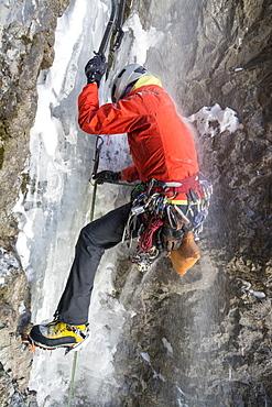 A woman ice climbing near Ouray, Colorado.