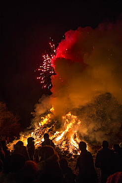 People Amidst Bonfire Against At Night, Dardago, Friuli, Italy