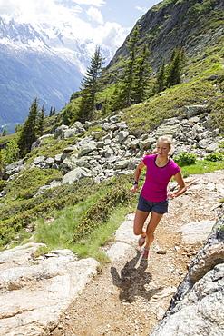 Girl Running Uphill In The Chamonix Valley