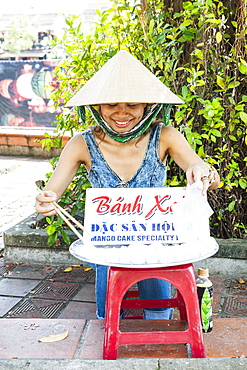 Woman Selling Sweet Buns On The Street In Hoi An