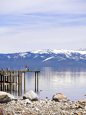 Mother With Her Son Walking On Boardwalk Exploring Lake Tahoe In California, Usa