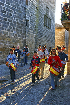 Kids With Drums Walking In The Old Town Of Baeza, Andalucía, Spain, Europe