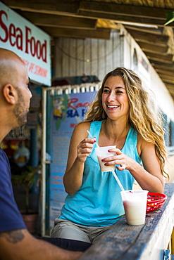 A Woman Enjoying A Pina Colada At Bar In Puerto Rico