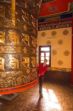 Happy Man Spinning A Giant Prayer Wheel At Tashiding Monastery, Sikkim, India