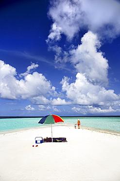 Tourist Strolling And Sunbathing Around A Small Sandbank In Gulhi, Maldives