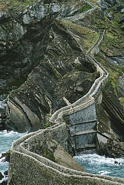 Walkway To Island Of San Juan De Gaztelugatxe In Basque Country