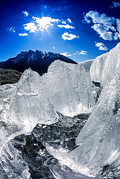Icy shoreline of mountain lake in spring