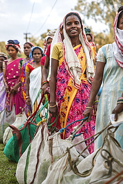 A Tea Picker Woman Standing In Line To Weigh Their Harvest Of The Day