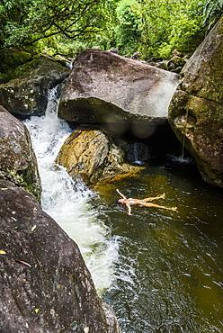 Woman bathing in Pirapetinga River in Serrinha do Alambari, Rio de Janeiro, Brazil