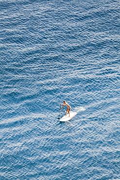 SUP girl enjoying in a beautiful sea