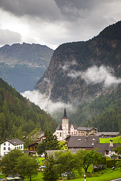 The pink church of mountain village Trient in the Swiss Alps.