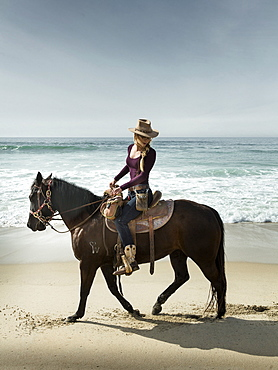 Horserider stroll a beach in Imperial Beach, California near the Mexican border.