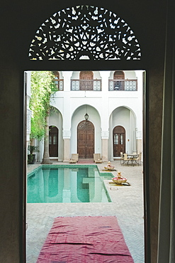 Empty swimming pool in courtyard of Moroccan riad, Marrakech, Morocco
