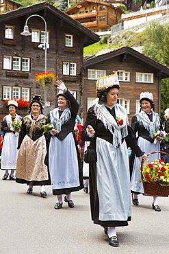 Women in traditional Swiss dresses on parade in Zermatt, Valais Canton, Switzerland