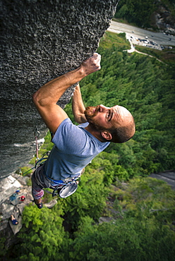 Adventurous rock climber climbing challenging cliff, Squamish, British Columbia, Canada