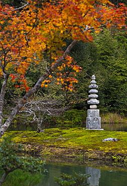 Small pagoda in garden in autumn, Kyoto, Japan
