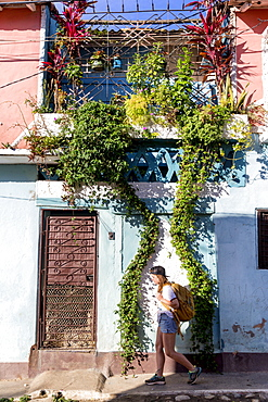 Side view of female tourist walking on street in Trinidad, Sancti Spiritus Province, Cuba