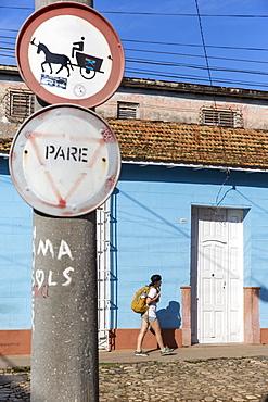 Side view of female tourist walking on street in Trinidad, Sancti Spiritus Province, Cuba