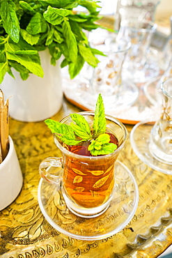 Close-up of glass of traditional tea with mint leaves, Madaba Governorate, Jordan