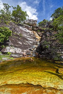 Two men bathing near Cachoeira do Abismo Abyss Waterfall, Chapada dos Vedaeiros, Goias, Brazil