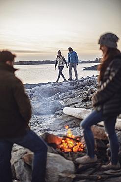 Group offriendsaroundbeachsidecampfire, Peaks Island, Maine, USA