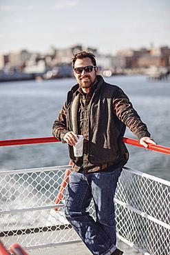 Portrait of bearded man wearing sunglasses riding ferry to Peaks Island, Portland, Maine, USA