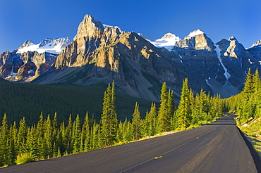 View Of Glacial Mountains And Trees Along The Road To Lake Moraine In Banff National Park; Alberta Canada