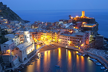 Buildings Along The Waterfront Illuminated At Night; Vernazza Liguria Italy
