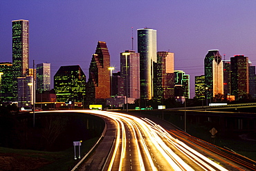 Streaking Car Lights At Night And Downtown Houston In Usa